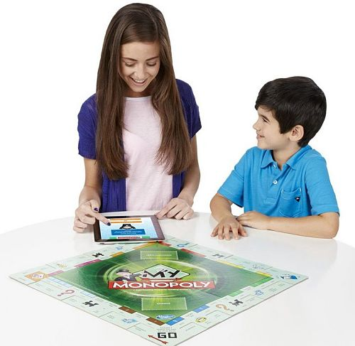 Kids look at the app for the personalized monopoly game version